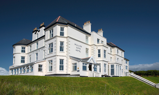 Set high on the cliffs above Mullion Harbour this Victorian hotel has uninterrupted views of the dramatic Cornish coastline.