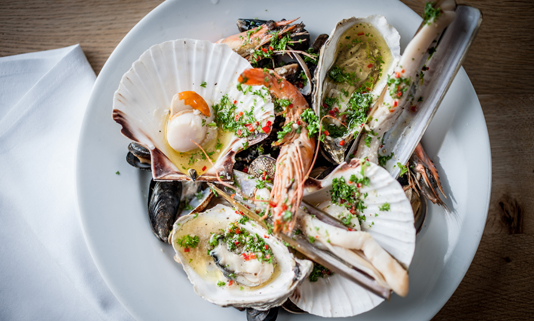 Rick Stein's seafood restaurant in Falmouth serves his favourite dishes such as grilled sea bream fillets, moules marinière, grilled lobster, shucked oysters.
