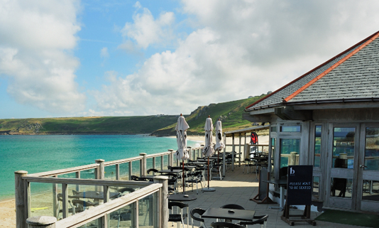 Nestled alongside the sand dunes one mile north of Land's End you will stumble upon the 'Beach' restaurant complex, which boasts uninterrupted, breathtaking, panoramic views of the expansive white sands and turquoise waters of Sennen Cove.